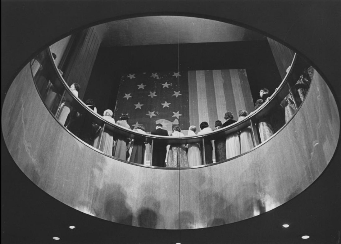 Looking up at the Star Spangled Banner flag through the Foucault  Pendulum at President Richard Nixon's Inaugural Ball